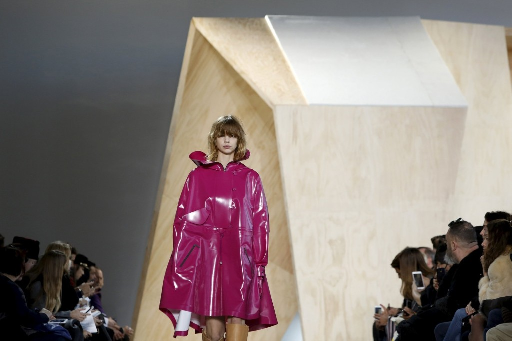 A model presents a creation from the Lacoste
