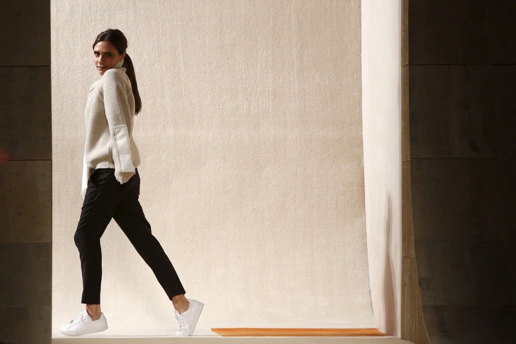 Designer Victoria Beckham acknowledges attendees after presenting her Fall/Winter 2016 collection