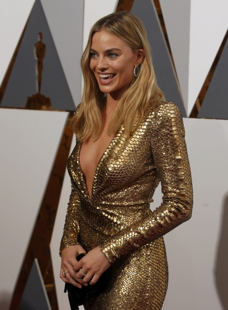 Margot Robbie arrives at the 88th Academy Awards