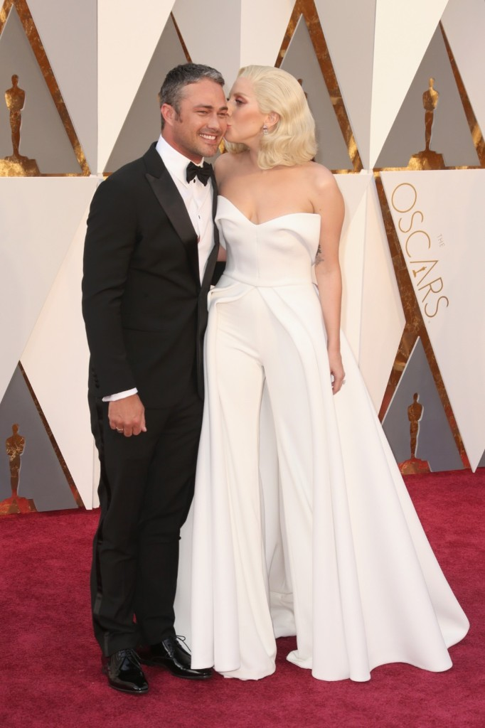 Taylor Kinney and Lady Gaga attend the 88th Annual Academy Awards
