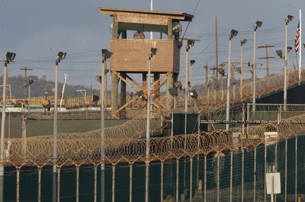 A US military member mans one of the watch towers at Camp Delta in Guantanamo Bay
