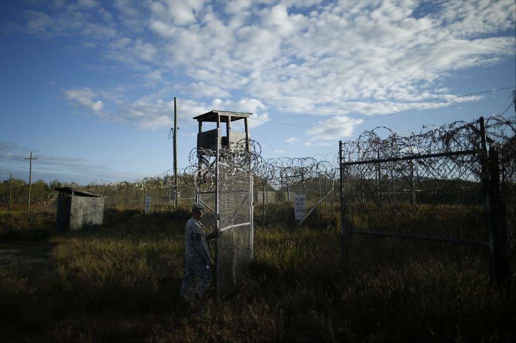 A soldier closes the gate at the now abandoned Camp X-Ray