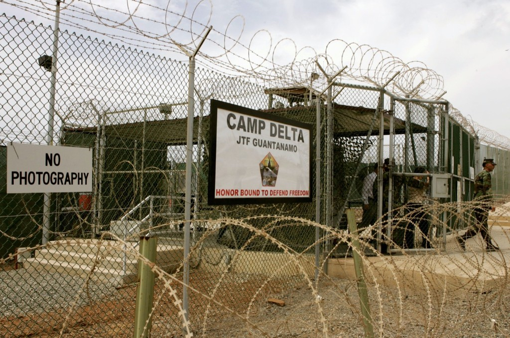 A soldier walks through a gate at Camp Delta at Guantanamo Naval Base