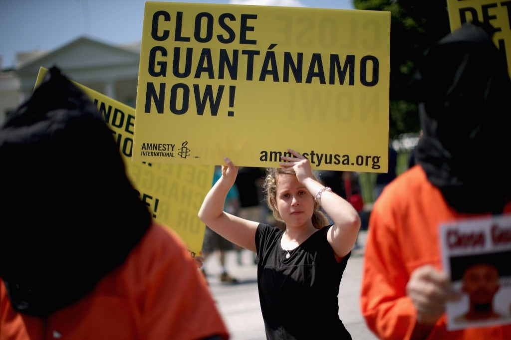 Demonstrators hold a rally to urge President Obama to fulfill his pledge to close the military prison at Guantanamo Bay