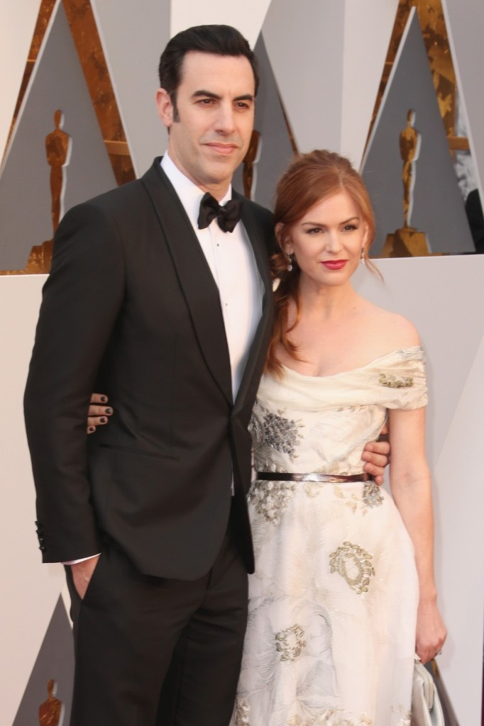 Sacha Baron Cohen and Isla Fisher attend the 88th Annual Academy Awards