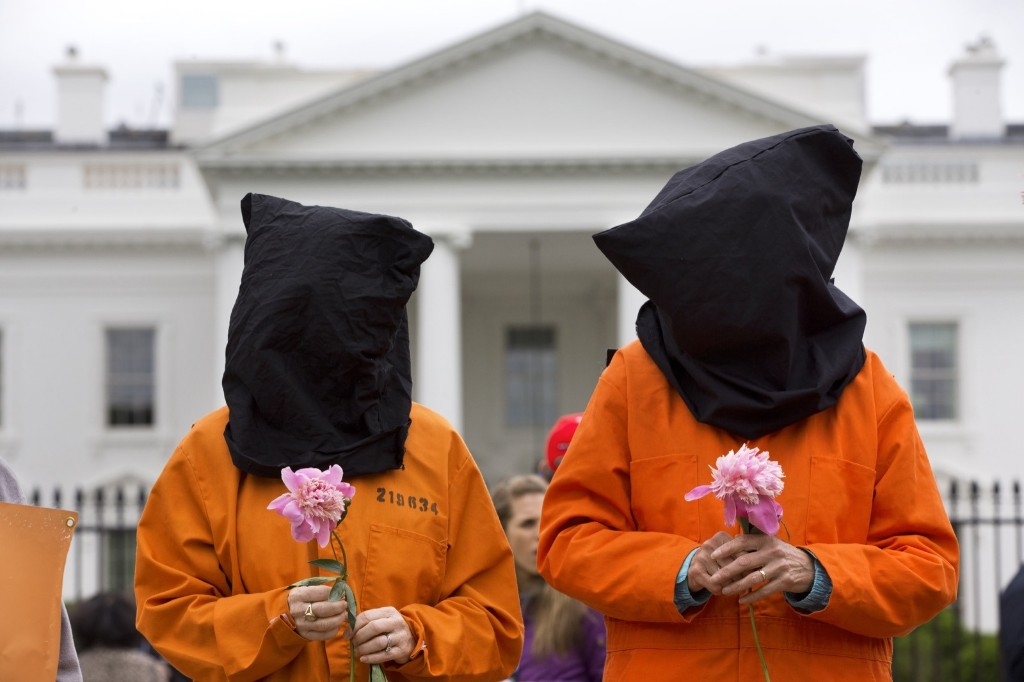 Two protesters take part in a demonstration in front of the White House