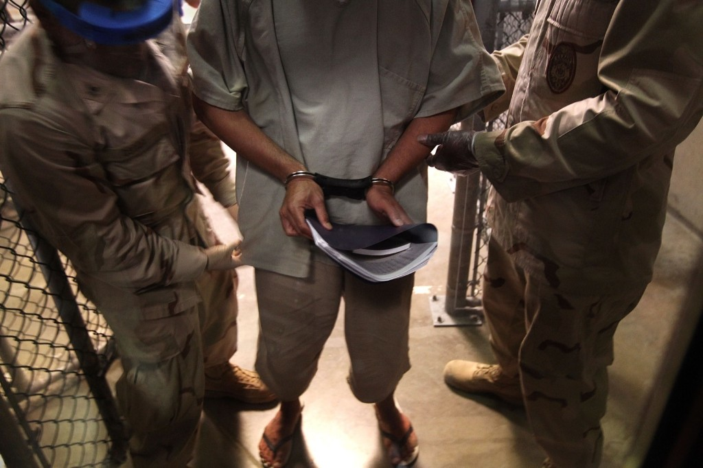 U.S. Navy guards escort a detainee