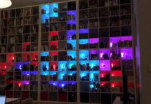 giant tetris game made from bookshelf