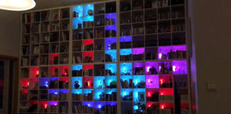 giant tetris game made from bookshelf